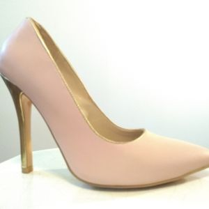 Baby pink pumps with gold heels.